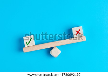 Tick mark outweighs cross mark on and imbalanced seesaw. Concept of positive evaluation in decision making, approval or voting.  Stock photo ©