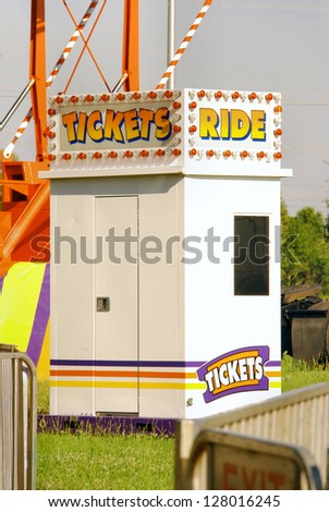 Ticket Booth sells tickets for rides at a rural carnival.