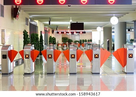 Ticket checkers at entrance of subway station.