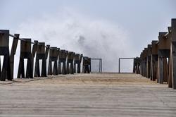 Tidal wave against pier at balearic island Lanzarote, Spain - Atlantic Ocean