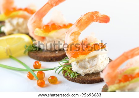 Tidbits with prawns, spiced cream cheese and salmon caviar