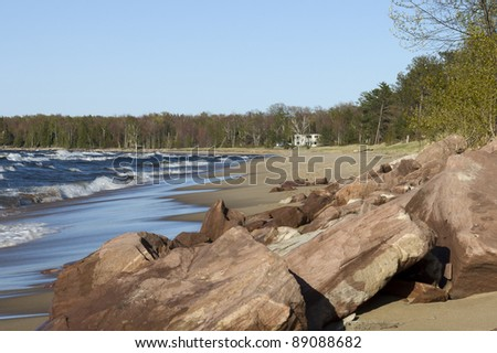 Tide coming in and rolling over  the sandy beach of Lake Superior, Michigan, USA