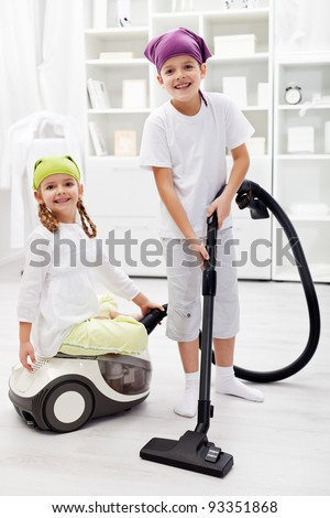 Tidy up day - children cleaning their room using the vacuum cleaner