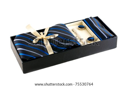 tie and cufflinks in box isolated over white