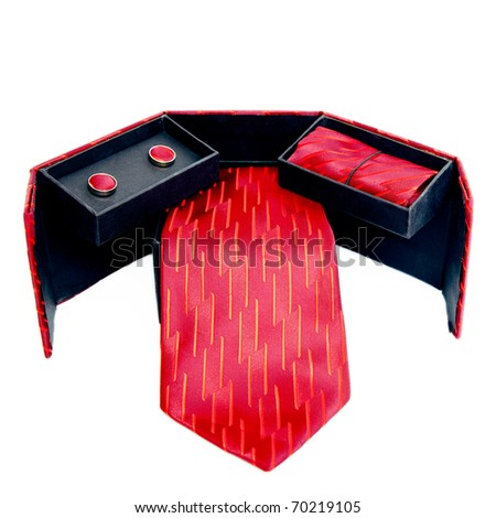tie and cufflinks on a white background, set of tie and cufflinks