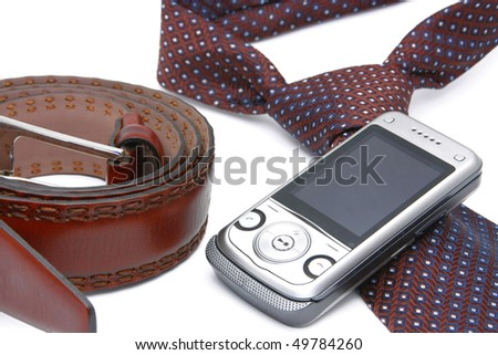 Tie, belt and phone on a white background. Male accessory