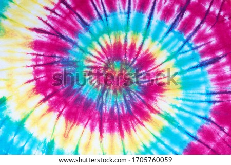 tie dye pattern hand dyed on cotton fabric abstract texture background.