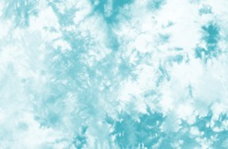 tie dyed pattern on cotton fabric background.