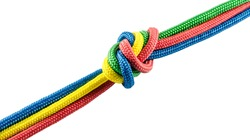 Tie from colorful ropes isolated on white