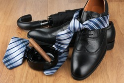 Tie, shoes and men's accessories. Men's classic fashion. Shoes with tie.