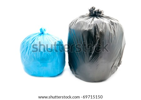 Tied black and blue garbage bags isolated on a white background.