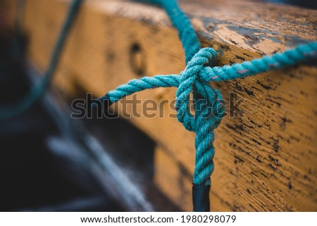 tied rope knot on wooden fence Stock photo ©