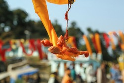 Tied to a vehicle flying Hanuman idol hanging in air with blurred background. Selective focus. Hindus tie this flying Hanuman idol to feel the spiritual safety in their journeys