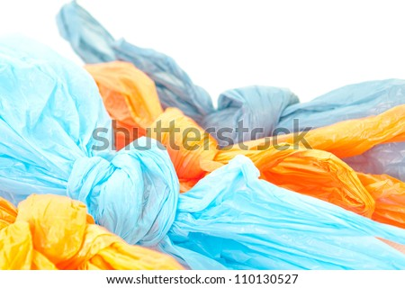 Tied up plastic bags on a white background