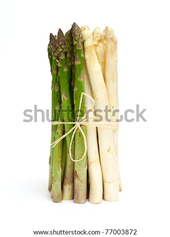 tied white and green asparagus on white background