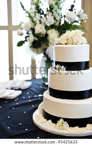 tiered wedding cake with roses on top