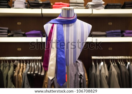 Ties on the mannequin in shop for men