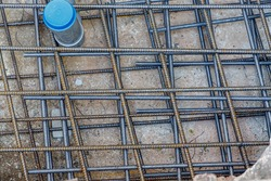 Ties wire reinforcement on the ground before cementing, Rusty rebar steel mesh on street used for reinforced concrete of building, Construction site work.