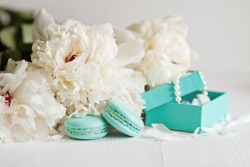 Tiffany blue macarons with peony and gift boxes
