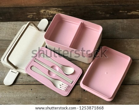 Tiffin food container or food container made of wheat straw, on old wood background, with dark tone. Biodegradable plastic, Compostable container. Reduce the use of plastic with concept.