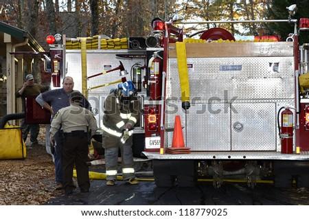 TIGER, GA, USA - NOV. 9: A group of firemen getting ready to fight a house fire. November 9, 2012, on Lake Burton.