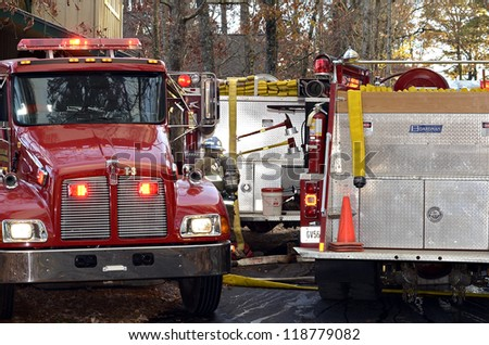 TIGER, GA, USA - NOV. 9:  Firetrucks and firemen at the site of a house fire.  November 9, 2012, on Lake Burton.