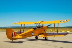 Tiger Moth Airplane ready for take off. Yellow 1940 Vintage Bi plane