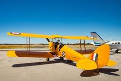 Tiger Moth Airplane ready for take off. Yellow 1940 Vintage biplane