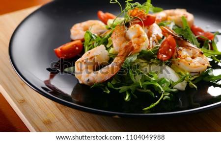 Tiger prawns with greens. Seafood salad. close-up