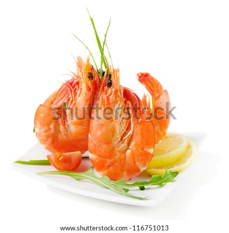 Tiger shrimps with fresh vegetables isolated on white
