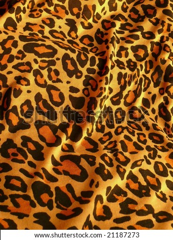 Tiger speckles textile closeup background. More of this motif & more fabrics in my port.