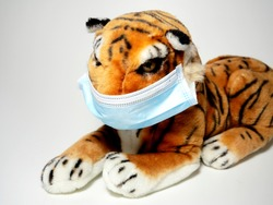 Tiger with protective mask cuddly toy