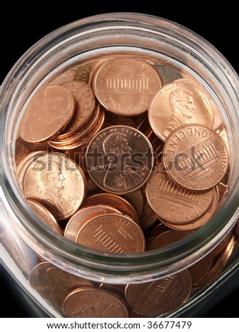 Tight shot of shinny pennies in a vintage jar.
