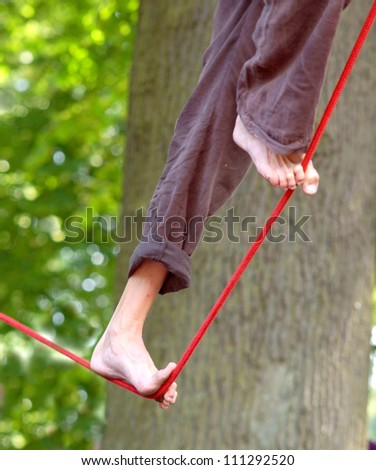 tightrope walker performes in the park