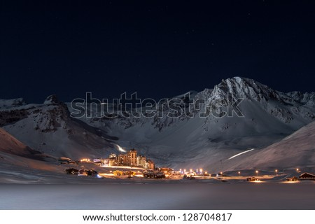 Tignes Val Clares at night shines in surrounded by mountain peaks