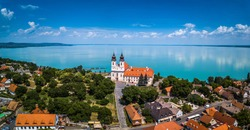 Tihany, Hungary - Aerial panoramic view of the famous Benedictine Monastery of Tihany (Tihany Abbey) with beautiful colourful Lake Balaton at background
