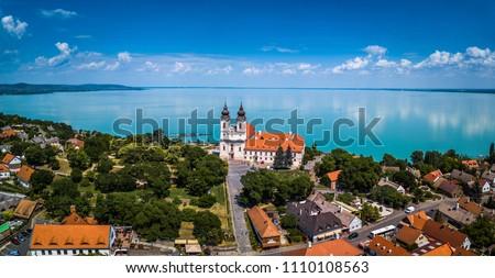 Tihany, Hungary - Aerial panoramic view of the famous Benedictine Monastery of Tihany (Tihany Abbey) with beautiful colourful Lake Balaton at background Stock photo ©