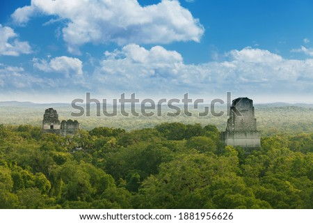 Tikal, Guatemala. View from Temple IV on limestone temples in the jungle.
