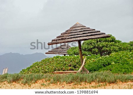 Tiki Hut Umbrella and Lounge Chairs in Tropical Kauai Hawaii Beach