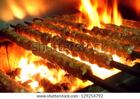 tikka, shish & kofta kebabs on charcoal barbeque