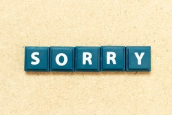 Tile alphabet letter in word sorry on wood background