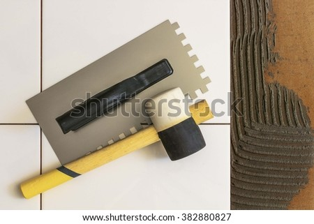 Tile and trowel with a mallet. #382880827