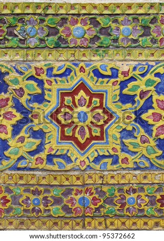 Tile art on the temple wall Wat thailand