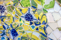tile background broken glass mosaic, decoration in Park Guell, Barcelona, Spain. Designed by Gaudi