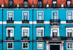 Tile covered colourful building in Lisbon Portugal. The tiled buildings and street art of Lisbon.