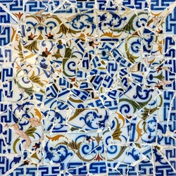tile decoration, broken glass mosaic in Park Guell, Barcelona, Spain. Designed by Gaudi