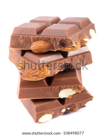 Tile milk chocolate with almonds closeup on white