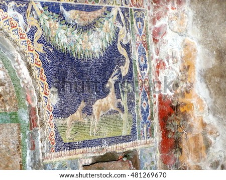 Tile mosaic on the wall of a building in Herculaneum, Italy, which was buried in ash in the eruption of Mount Vesuvius in 79AD