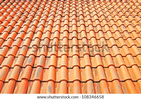 Tile Roof   Detail of a red clay tile roof.