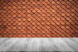 Tile roof of old Thai temple texture background surface natural color , process in vintage style with wood terrace